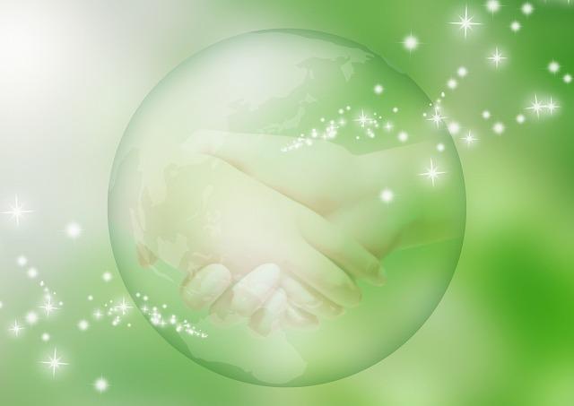 地球と握手の図
